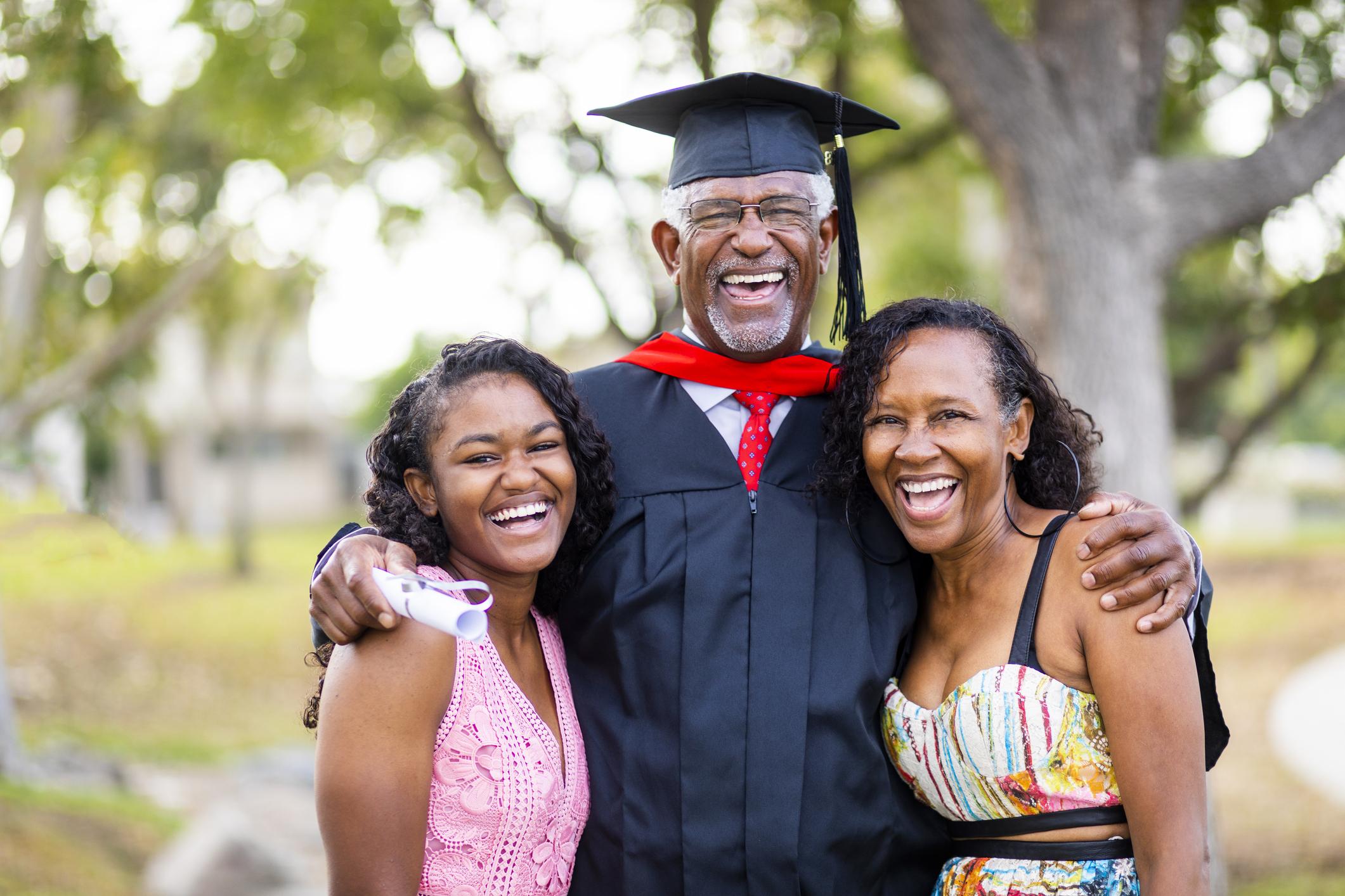 Senior Black Man Graduate with Family